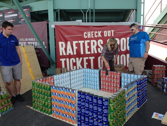 Riverview Hospital employees stack cans for their Rubik's