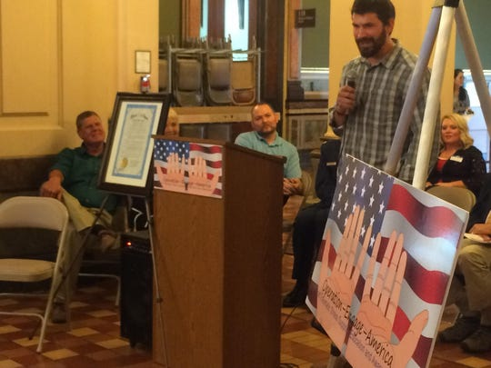 Brandon Lay, Marine Corps veteran, shares what he wishes he could say to veterans who have taken their own lives at the Operation Engage America resource fair Saturday, June 20, at the State Capitol rotunda.