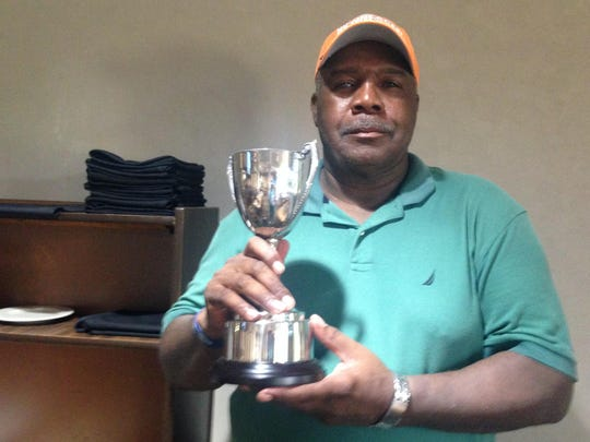 Leroy Murphy poses with his trophy after winning the