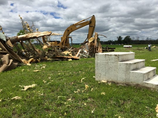 Steps leading to nowhere were found beside the debris of a mobile home Tuesday, June 23, 2015 in Sandusky.