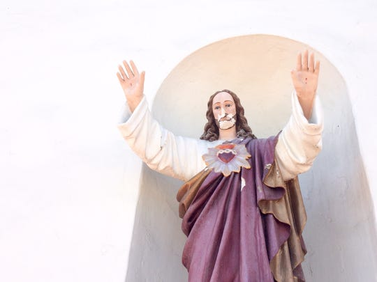 A statue of Jesus was vandalized at Our Lady of Solitude Church in Palm Springs Thursday.