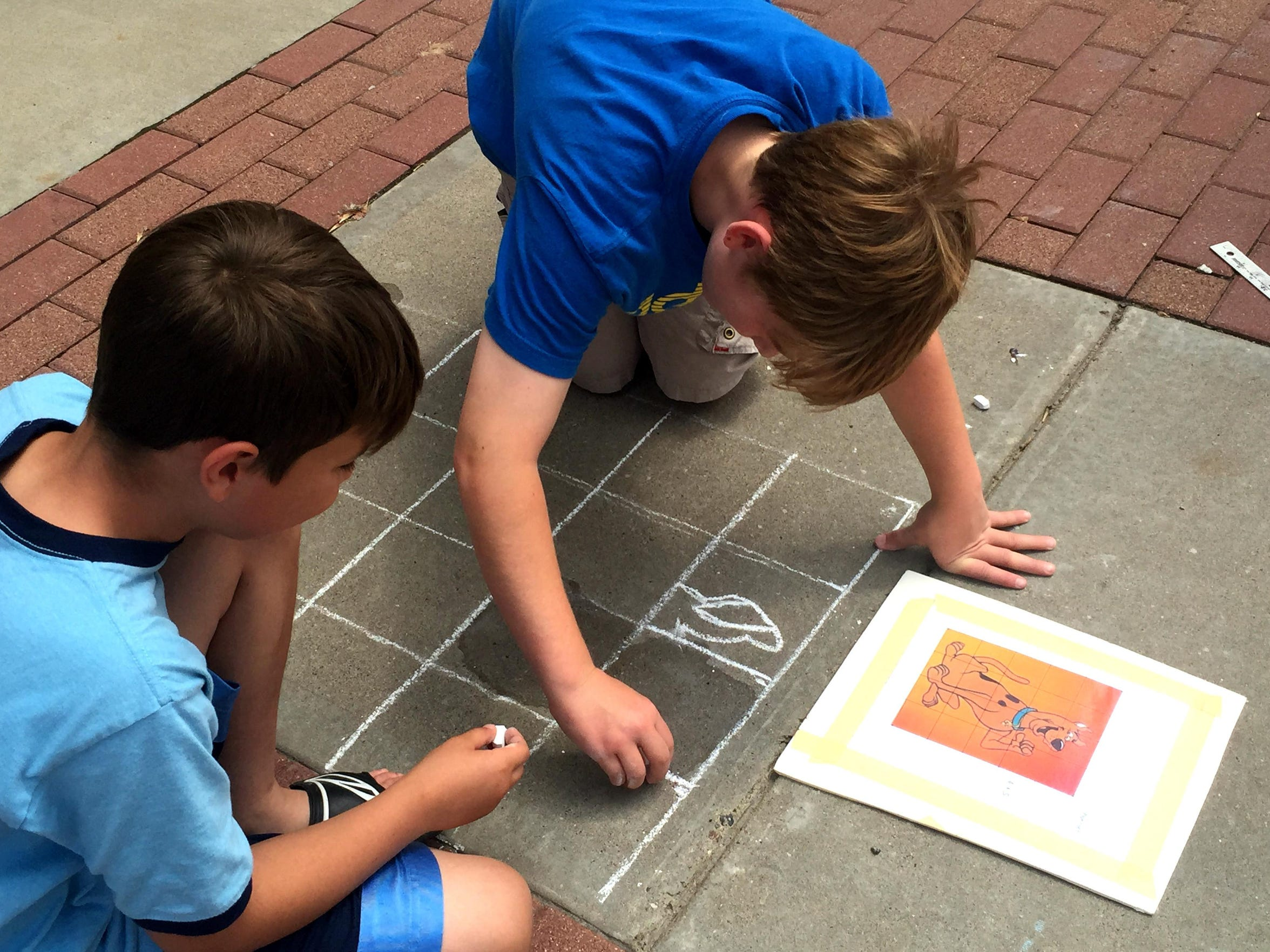 To reduce crookedness and uneven lines, artists can use a grid to divide the picture they plan to recreate at Chalkfest into squares.