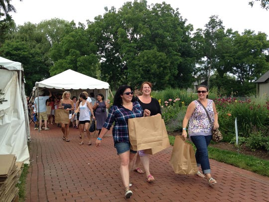 Customers enter the shopping area at the MacKenzie-Childs Barn Sale in Ledyard, Cayuga County on July 18, 2015.