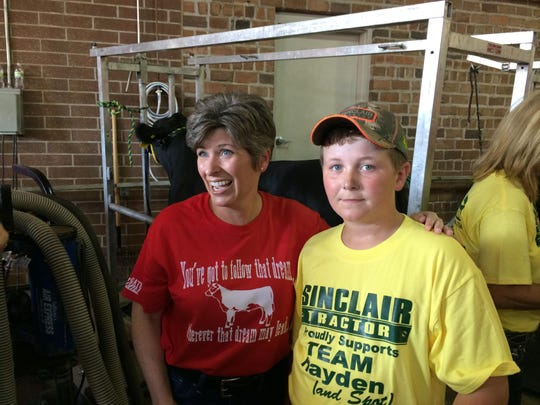 Hayden Watson, 11, poses for a photo with Iowa U.S.