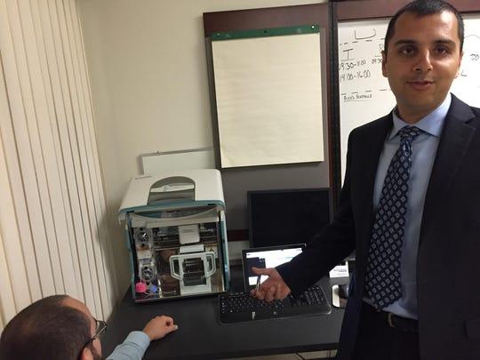 Al Katawazi, 35, of Rochester explains how the device