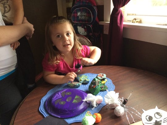 Jocelynne Wenger, 3, daughter of Rachel Renner, plays with some of the craft projects that will be available at the first Crafty Kids gathering Oct. 24 at the Rapids Mall.