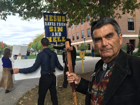 Brother Jed Smock and members of his Campus Ministry USA preached fire and brimstone to students at Purdue University on Thursday. The ministry travels the campuses, riling students with provocative messages about eternal damnation.