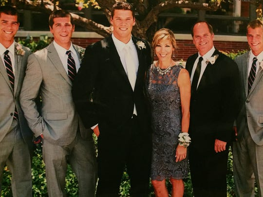 The Fisher family, from left: Cole, Ryan, Sean, Cathy, Todd, Clay.
