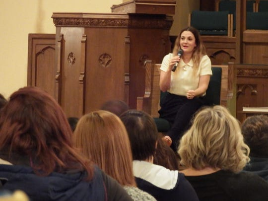 Drew Barrymore speaks to a crowd of over 700 people