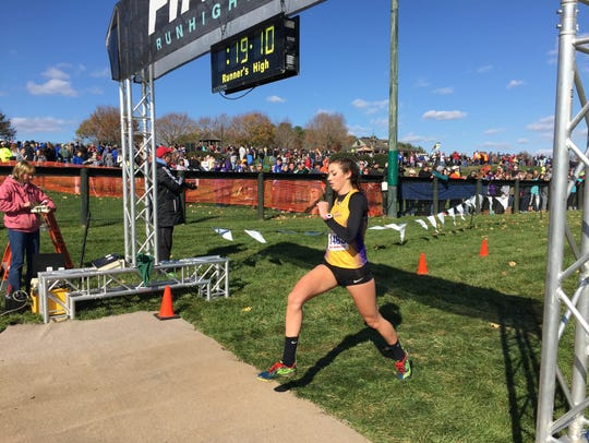 Waynesboro's Grace Brooks crosses the finish line of