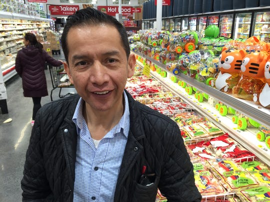 Osvaldo Carrera, manager and co-owner of Food Fair supermarket in Spring Valley, beside the international frozen food case in the newly opened store on Route 59 in Spring Valley. Carrera said Food Fair, a hybrid traditional market and bulk warehouse, draws customers from New City, Nyack, Suffern and beyond, representing cultures and appetites from Central and South America, Russia and Poland.