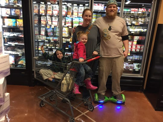 Kevin Kuhn rides his hoverboard through Earthfare while shopping for groceries with his family. He said most businesses embrace the new technology.