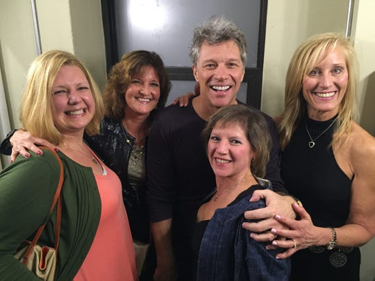 Jon Bon Jovi with the ladies of Mary's Place by the Sea backstage at the Count Basie Theatre in Red Bank on December 23.