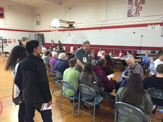 A precinct captain explains the caucus process Feb. 20 at the Democratic caucus at Fernley Intermediate School.