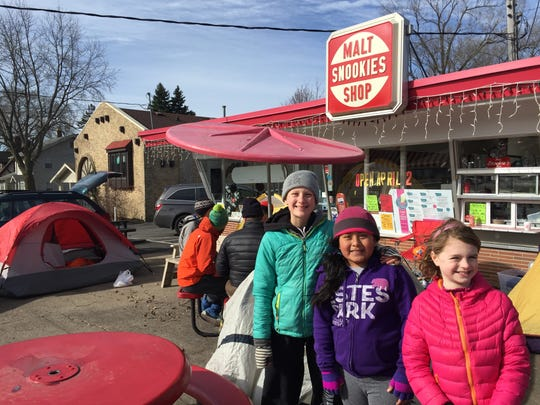 From left, Sage Halfhill-Boone,13; Maya Weakland, 9; and Caroline Ramsey; all camped overnight outside Snookies' ice cream shop in Beaverdale  to be among the first in line for ice cream Saturday as the shop opened for the first time in 2016.