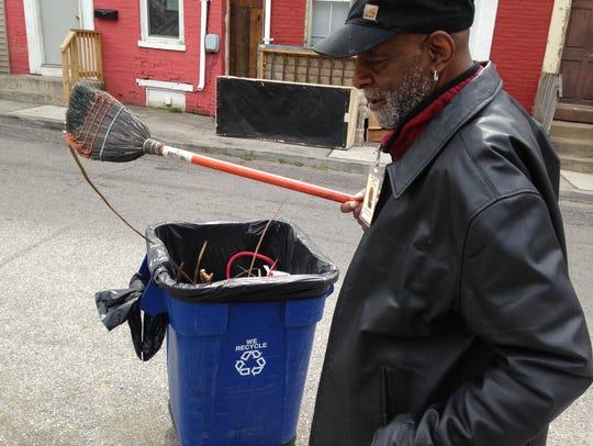 Leonard McKinney, 66, of York, shakes off his broom