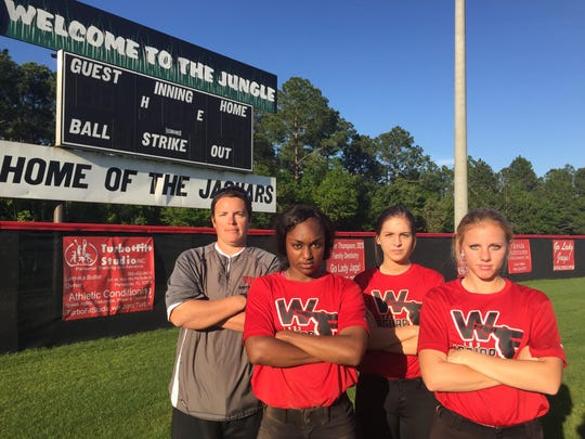 West Florida seniors (from left) Jibrasha Moore, Maegan Freeman and Farrah Nicholas hope to send outgoing coach Jessica Smith (far left) out in style this postseason.