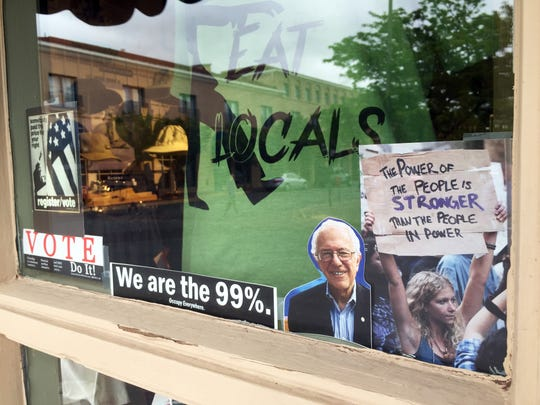 Support for Democratic presidential candidate Bernie Sanders is on prominent display on May 18 at Santa Fe Hemp in downtown Santa Fe. Store owner Kathlene Savage has sold thousands of bumper stickers and T-shirts tagged with Sanders policy talking points.