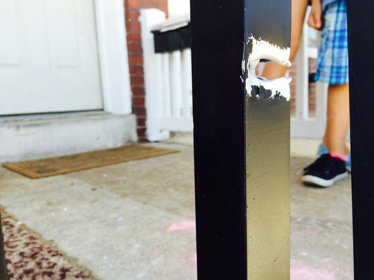 This is the railing on the porch of Cisco Soto's apartment in York. It had apparently been struck by  two bullets.