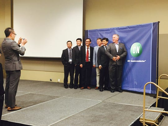 Supplier executives line up for impromptu photos at a recent ON Semiconductor conference in Phoenix.