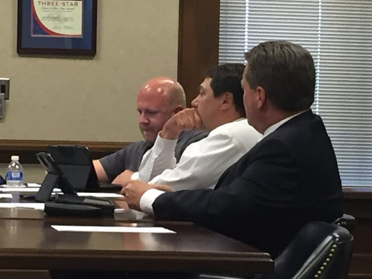 Commissioners Mark Riggins, from left, Larry Rocconi,