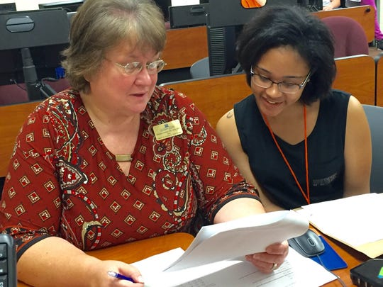 Marilyn Cooksey, dean of Louisiana College's School of Nursing, advises Brittany Milo (right) of Alexandria as she pre-registers for fall 2016 classes at the private Baptist college.