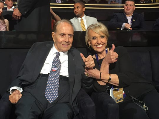 Former Arizona Gov. Jan Brewer sits with former U.S. Sen. Bob Dole and 1996 Republican presidential candidate.
