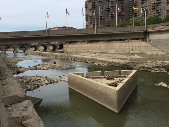 A defunct fountain structure sits in the Genesee River