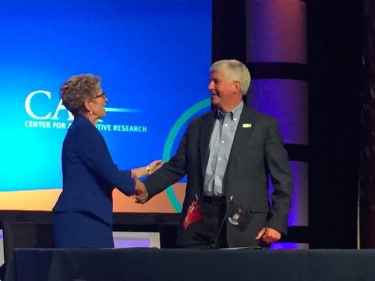 Ontario Premier Kathleen Wynne and Michigan Gov. Rick Snyder sign an agreement pledging regional cooperation to promote the automotive industry on Wednesday, Aug. 3, 2016 in Traverse City at the Management Briefing Seminars
