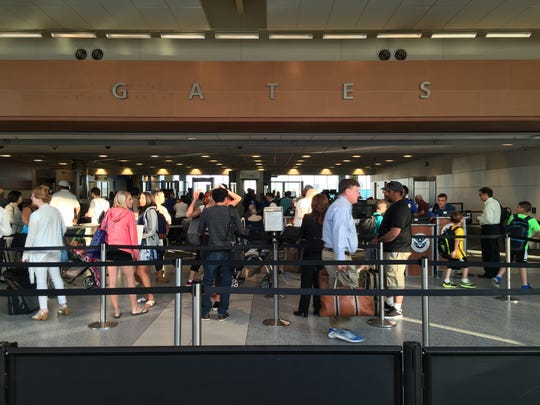 Passengers navigate security lines at Detroit Metro Airport's North Terminal in this file photo.
