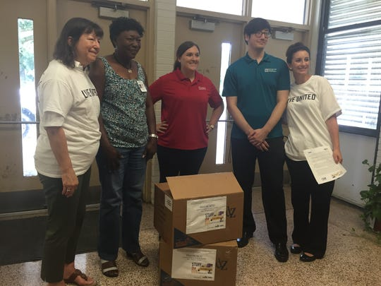 The United Way of Acadiana staff and local volunteers delivered school supplies to more than 40 area schools Thursday.