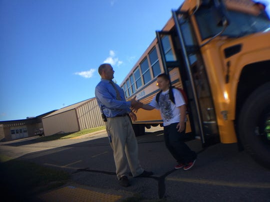 Weston Ele. - 8:39 a.m. Principal Fritz Lehrke greets students as they get off school buses.