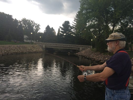 Art Robson, an Amherst resident, fishes near the newly
