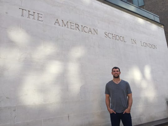 """Colts quarterback Andrew Luck poses in front of the American School in London, where he and his sisters attended. """"There's something like 50 years of schooling for the Luck's in London,"""" Andrew noted proudly."""