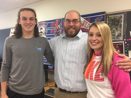 Joe Schieve with two of his senior business students:
