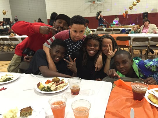 Some of the youngsters at the Southside Thanksgiving Dinner goof off for a photo.