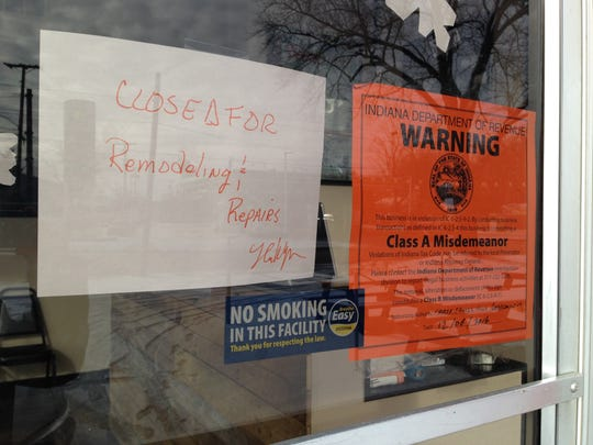 Two signs are posted at RP's Pizza on 1700 Wheeling Ave. One reads the restaurant is closing for remodeling, while the other implies the owners did not have proper certification.