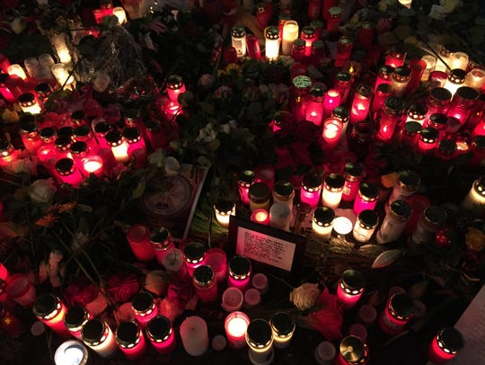 Memorial candles and signs at Breitscheidplatz Christmas