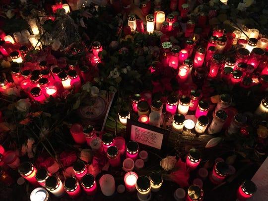 Memorial candles and signs at Breitscheidplatz Christmas