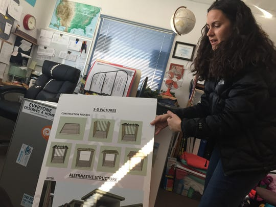 Nicole Martinez, executive director of Mesilla Valley Community of Hope, explains the designs for new, three-sided structures being installed at Camp Hope to protect residents and their tents from the elements. The ongoing project has, so far, provided four Adirondack structures for the camp.