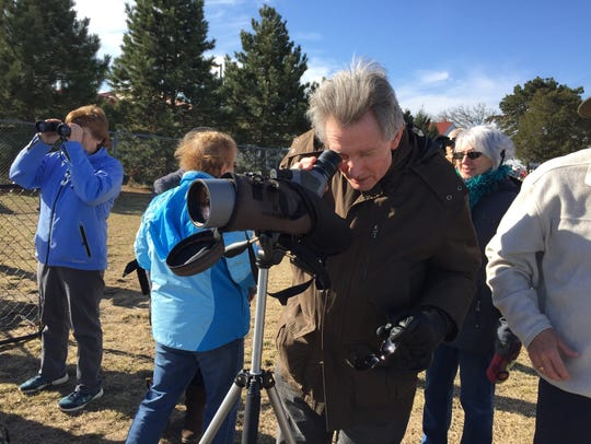 Marty Habalewsky, of Port Huron, looks at flock of