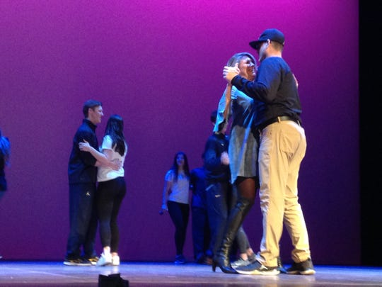 Jim Harbaugh dances with wife Sarah at the Mock Rock