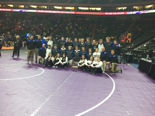 The Foley wrestling team poses after finishing fourth in the state Class 2A tournament Thursday at the Xcel Energy Center.