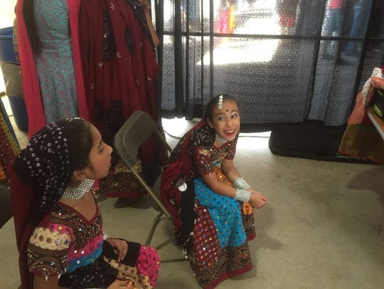 Two girls at Indiafest in Melbourne relax after their