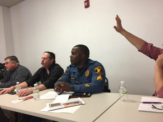 Michael Golub, (left), Township Committee member Robert Lane, and Officer Gregory Washington discuss gun violence in Neptune at a community forum.