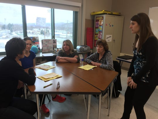Sarah Miller, right, helps facilitate a conversation about bibliotherapy at Vestal High School.