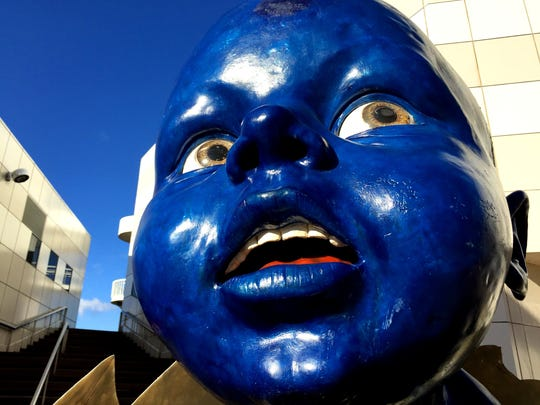 This blue statue in front of the Fitton Center for