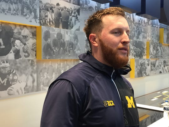 Michigan running backs coach Jay Harbaugh speaks after