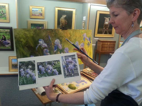 Artist Anne Bialk offers an arts demonstration as part