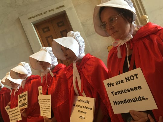 Abortion-rights protesters silently demonstrate outside the Tennessee state Senate chamber.